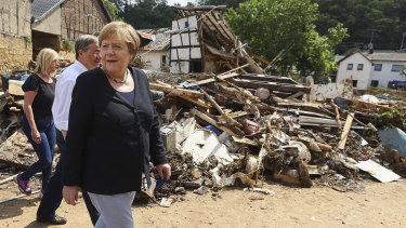 German Chancellor Angela Merkel, inspecting a flood-affected area.