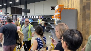Shoppers queuing for toilet paper at Woolworths in Marrickville last Saturday.