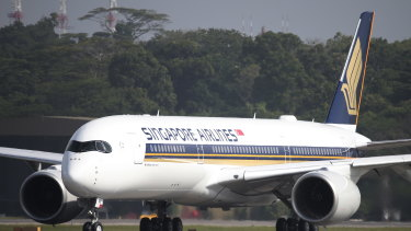 A Singapore Airlines Airbus A350-900 taxies on the runway at Changi Airport in Singapore.