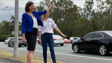 LNP leader Deb Frecklington (front) with Aspley candidate Amanda Cooper near the intersection of Beams Road and Gympie Roads in Carseldine. The party has promised a $90 million overpass at the junction.