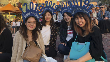 Japanese international students Hanae, Aoi, Yui and Madoka in Federation Square.