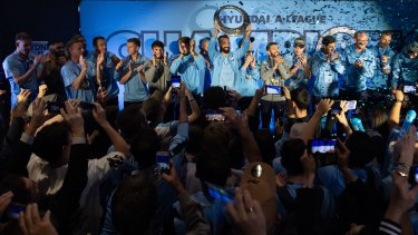 Hail the champs: Fans greet the triumphant Sydney FC team at The Star on Monday night.