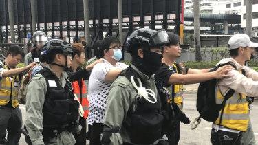 People wearing Save the Children vests arrested as they leave Polytechnic siege.