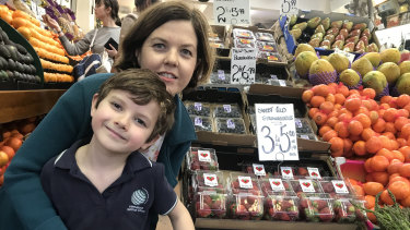 """""""I'm hoping that it hasn't scared everyone off buying strawberries."""" Kate Felloes and her son Bennett at Galluzzo's."""