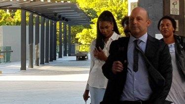 Olivia Muranga (left) outside Brisbane Magistrates Court with lawyer Dominic Brunello.