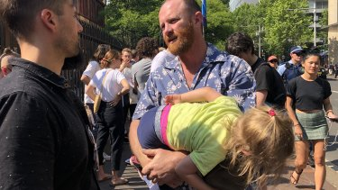 Aaron Crowe, with his three-year-old daughter Pepper, lost his house on Friday.