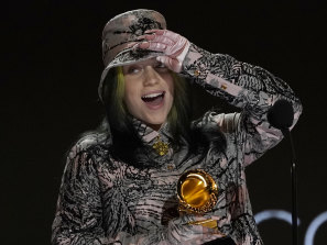 Billie Eilish reacts as she accepts the award for record of the year for Everything I Wanted at the Grammys.