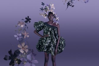 "Model Magnolia Maymuru wears  ""Seed Pods"" dress by Grace Rosendale, 2019, silk organza, courtesy of the artist, Hopevale Arts and Cultural Centre and Queensland University of Technology."