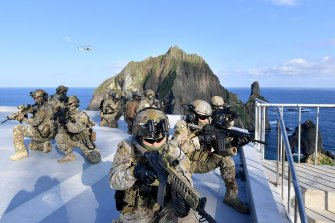 Members of the South Korean Navy's special forces participate in a drill on islets called Dokdo in Korean and Takeshima in Japanese.
