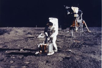 Buzz Aldrin conducts an experiment on the surface of the moon.