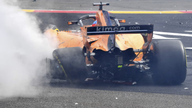 The damage to Fernando Alonso's car.