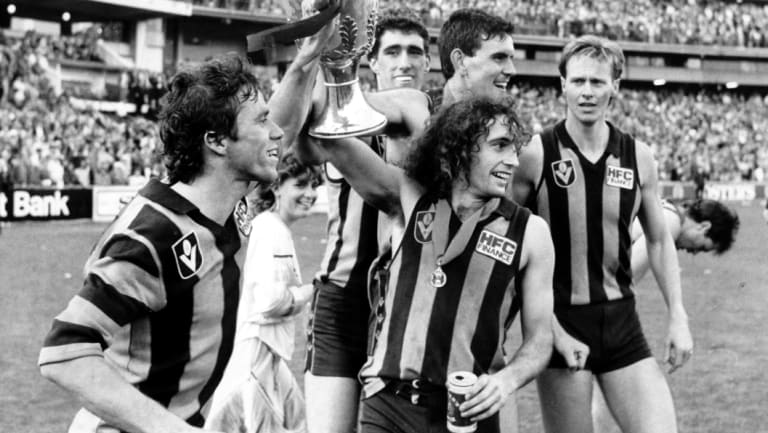 Long-term effects: John Platten with the premiership cup, right, in 1986. He is among a group of ex-players preparing for litigation.