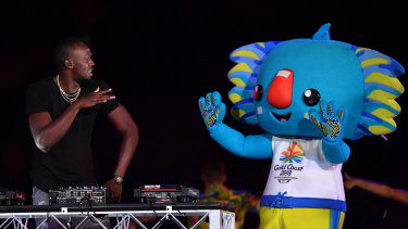 Usain Bolt performs on stage with Games mascot Borobi during the closing ceremony.