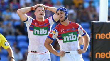 Pressure on: Knights Kalyn Ponga, right, and Lachlan Fitzgibbon after another Titans try on Sunday.
