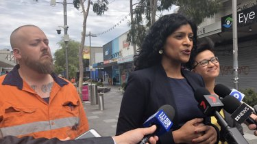 Victorian Greens leader Samantha Ratnam flanked by the party's Footscray candidate Angus McAlpine and upper houseMP Huong Truong