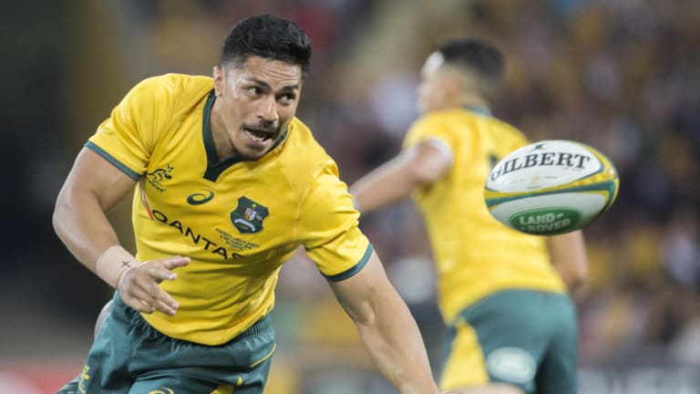 Natural in green and gold: Pete Samu offloads against South Africa in Brisbane.