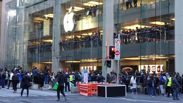 A small crowd of Apple fans queued early on Friday to get the new iPhone.