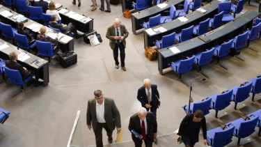 MPs of the Alternative for Germany and faction leader Alexander Gauland, centre, walk out.