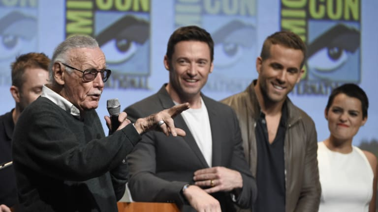 Stan Lee (left) with actors Hugh Jackman, who plays Wolverine, and Ryan Reynolds, who play Deadpool, in Comic-Con.