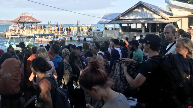 Mills and her friends in the crowd waiting to be evacuated from Gili Air.