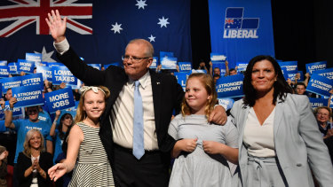 Prime Minister Scott Morrison with wife Jenny and daughters Abbey and Lily at a Liberal Party rally.