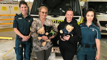 Queensland paramedics with Ron McCartney's family. Left to right: Hanna Hoswell, Sharon McCartney, Danielle Smith and Kate Hanafy.