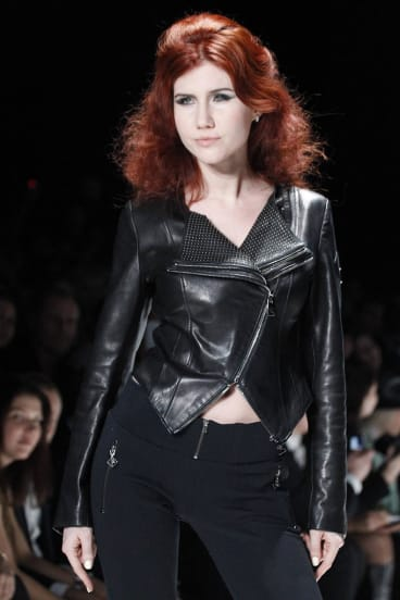 Anna Chapman, who was deported from the U.S. on charges of espionage, displays a creations by I Love Fashion.