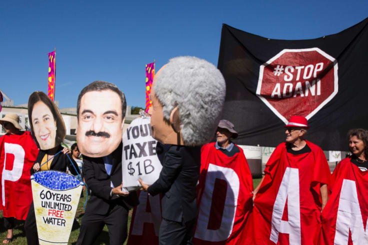 People gather at Parliament House in Canberra in February to protest the proposed Adani mine.