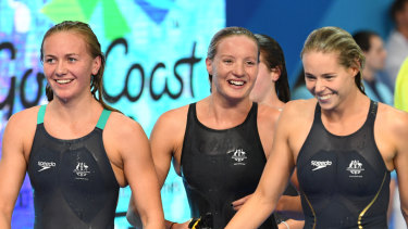 (L-R) Ariarne Titmus, Jessica Ashwood and Kiah Melverton of Australia react after winning coming first, second and third in the Women's 800m Freestyle Final on day five of swimming competition at the XXI Commonwealth Games at Gold Coast Aquatic Centre on the Gold Coast, Australia, Monday, April 9, 2018.  (AAP Image/Dave Hunt) NO ARCHIVING, EDITORIAL USE ONLY