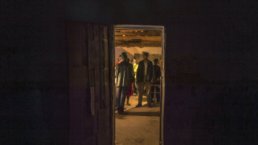 The last of the voters cast their ballots at a polling station near Harare, Zimbabwe, on Monday.