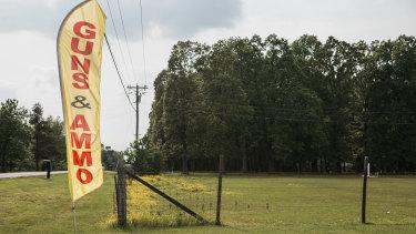 A roadside banner outside Personal Security Firearms in Benton, Kentucky.