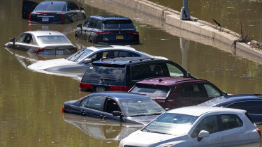 Cars are stranded by high water on the Major Deegan Expressway in the Bronx.