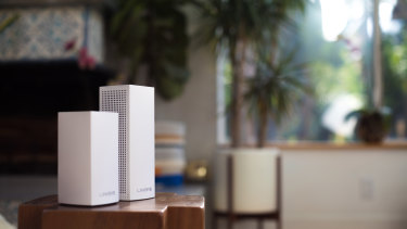 The new dual-band base stations work with the larger tri-band models, so you can mix and match.