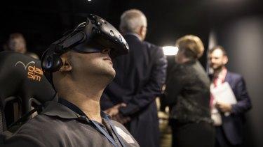 Lockheed Martin Australia systems integrator, Vikas Nayak, demonstrates the technology.
