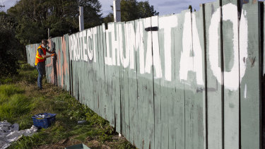 A fence painted with protest slogans at Ihumatao in Auckland, New Zealand.