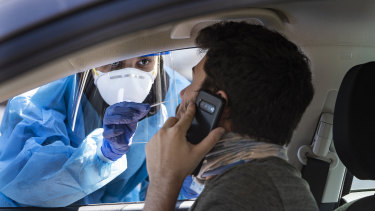 A man gets tested for COVD-19 in a drive-through setting in Minneapolis, Minnesota.