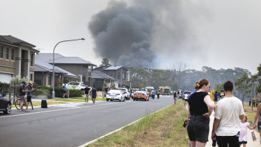 A fire is seen from Coach Street, Voyager Point, in Sydney's south-west on January 5, 2020.