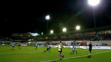Waratahs players warm up at Brookvale Oval.