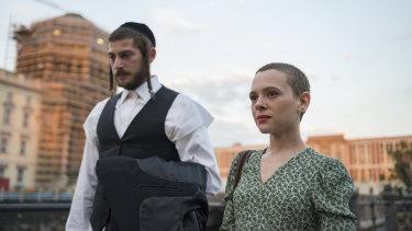 Esther Shapiro (Shira Haas) with her husband Yanky (Amit Rahav) in a scene from Unorthodox.
