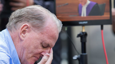 A victim of the Catholic church weeps as Judge Peter Kidd delivers his sentence in Melbourne.
