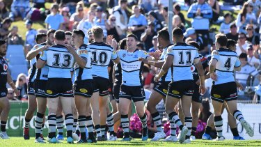 Surburban legend: The Sharks celebrate victory over the Warriors at Pointsbet Stadium.