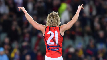 Dyson Heppell drinkls up the atmosphere at Adelaide Oval after the Bombers win on Friday night.