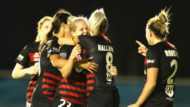 Kristen Hamilton celebrates her equaliser for the Wanderers.