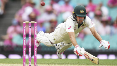 Joe Burns dives to make his ground on day three at the SCG.