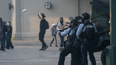 Minneapolis police shooting smoke bombs amid demonstrations after the death of George Floyd.