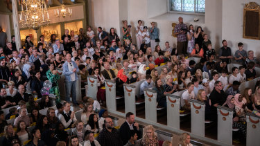 Families celebrate the end of the school semester at a church in Filipstad.