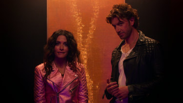 Billie (Sarah Shahi) with Brad (Adam Demos), her ex-boyfriend who has single-handedly ruined FaceTime for all of us.