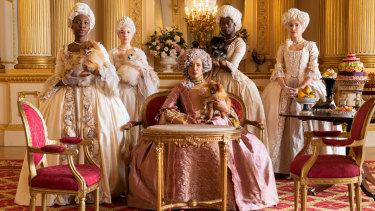 Golda Rosheuvel (centre) as Queen Charlotte in <i>Bridgerton<i>.