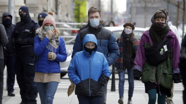 People walk on the streets of Warsaw, Poland, which has been hit by a sudden spike in new COVID-19 cases, as has much of central Europe and the Balkans.