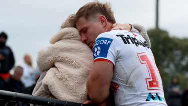 Jack De Belin reacts with his family after playing against Western Suburbs at Lidcombe Oval on his return to the game.